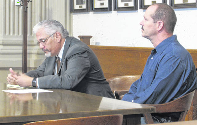 From left are Attorney E. Charles Bates representing his client Continental resident Michael T. Huizenga who has been charged with seven counts of rape and four counts of gross sexual imposition.