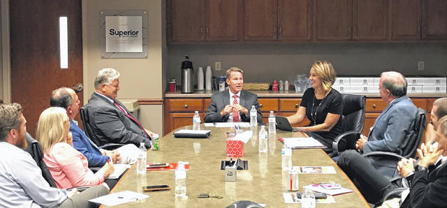 Lt. Gov. Jon Husted, center, talks workforce development with Lima area business leaders at the Lima/Allen County Chamber of Commerce on Wednesday.