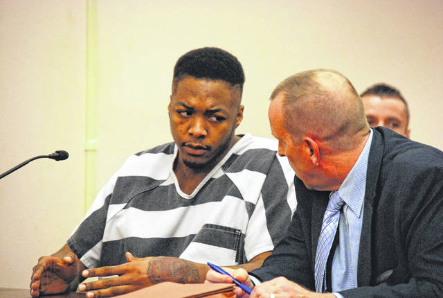 Lima resident Jazz Howell confers with his attorney, Kenneth Rexford, during a hearing Wednesday in Allen County Common Pleas Court.