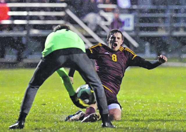 Kalida's Gabe Hovest attempts to score against Ottawa Hills Graham Tunis during Wednesday's Division III Regional Semifinal match at Graham Memorial Soccer Stadium in Findlay.