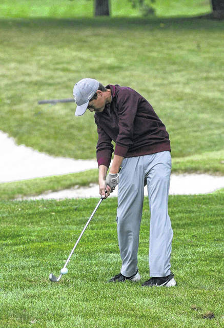 Kalida's Ryan Klausing hits out of the rough Friday on No. 9 on The Ohio State University Scarlet Course during the Division III state tounament.