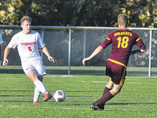Lima Central Catholic's Phil Venturella(5) dribbles against Kalida's Colin Erhart during a Wednesday Division III district semifinal at Kalida High School.