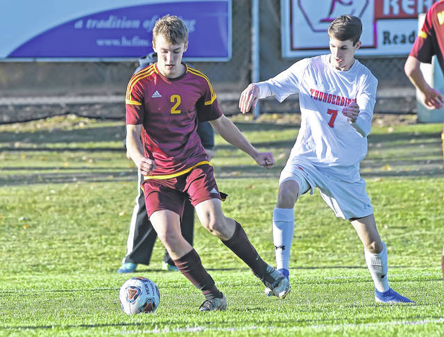 Kalida's Zach von der Embse (2) dribbles against Lima Central Catholic's Colin Guagenti during a Wednesday Division III district semifinal at Kalida High School.