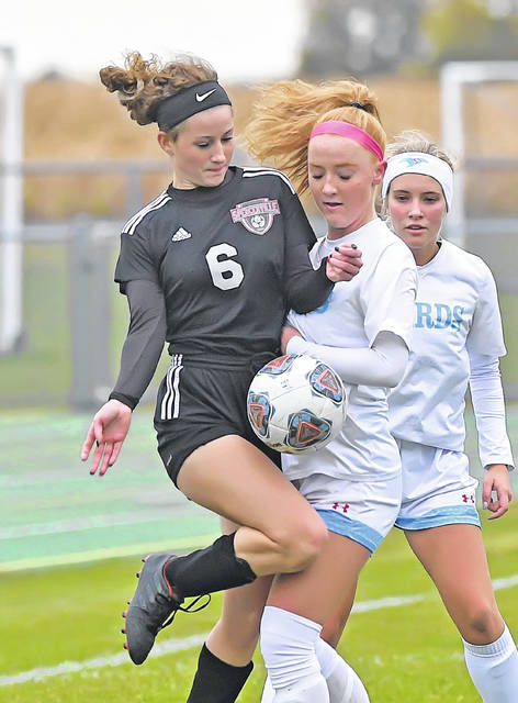 Spencerville's Ariana McMichael, left, and Lima Central Catholic's Annika Wilker compete for the ball during Tuesday's Division III District Semifinal match at Ottoville High School.