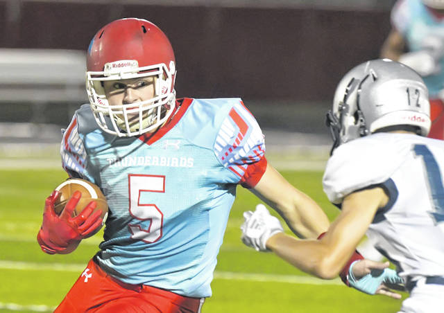 Lima Central Catholic's Michael Jay Riepenhoof looks to get past Woodlan, Indiana's Jacob Snyder during Saturday night's game at Spartan Stadium.