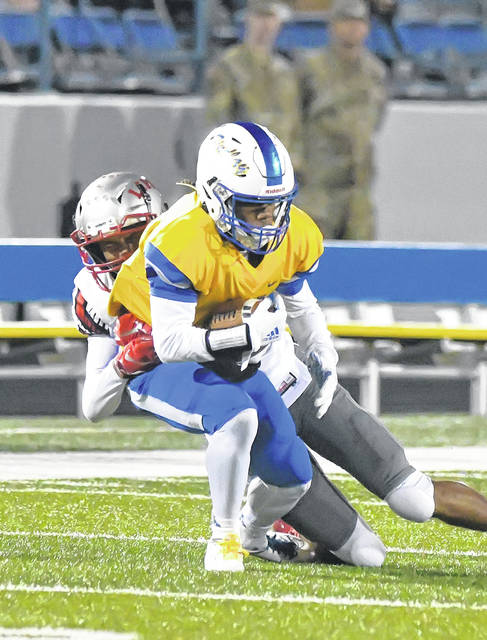 Lima Senior's Isaiah Funches-Foster tackles Findlay's Isaiah Moore during Friday night's game at Donnell Stadium in Findlay.