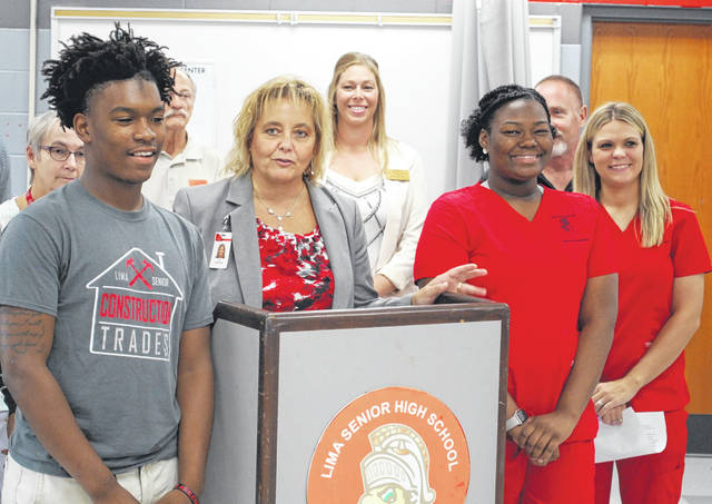 Jill Ackerman, superintendent of Lima schools, spoke glowingly of the career technical programs at Lima Senior High School during a news conference on Wednesday. She is flanked by students Jawan Anderson, left, and Te'Osha Williams.