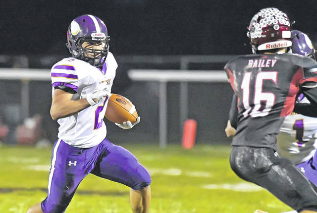 Leipsic's Fabian Pena looks for way around McComb's Ka'Von Bailey during Friday night's game at McComb.