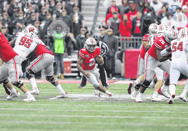 Ohio State running back J.K. Dobbins finds a hole to run through during Saturday's game against Wisconsin at Ohio Stadium in Columbus. Dobbins finished with 163 yards rushing and two touchdowns on the day. Don Speck | The Lima News