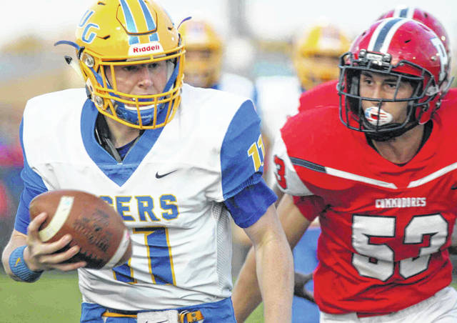 Waynesfield-Goshen's Cooper Roberts looks for open space against Perry's Tim Hendley during Friday night's game at Perry.