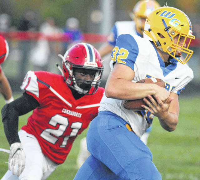 Waynesfield-Goshen's Kyle Searson looks to get past Perry's Devares Glenn during Friday night's game at Perry.
