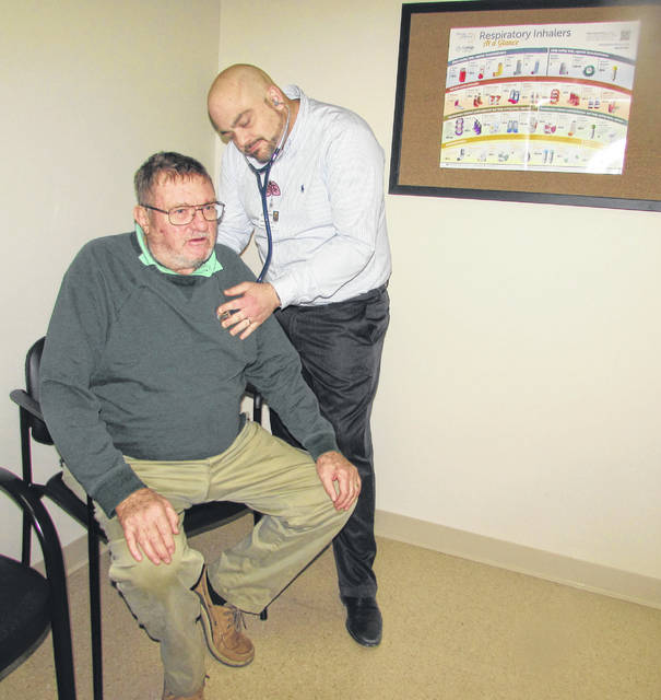 Dr. Jason Stienecker, Lima Memorial Pulmonary Center of Lima pulmonologist, provides a health checkup to Van Wert resident Chris Wilson on Monday following an innovative Spiration valve system procedure that took place in August.