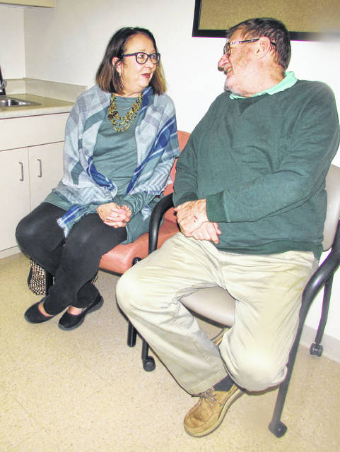 Jody and her husband, Chris Wilson, of Van Wert, talk in a waiting room about Chris's innovative Spiration valve system procedure.