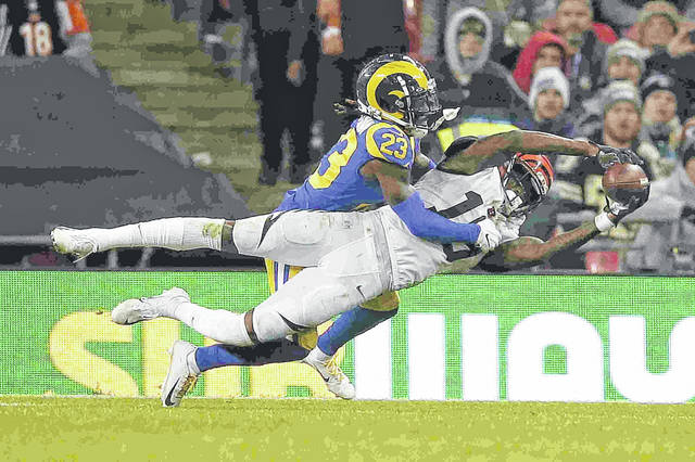 Los Angeles Rams defensive back Nickell Robey-Coleman (23) defends a pass against Cincinnati Bengals wide receiver Auden Tate during the second half of an NFL football game, Sunday, Oct. 27, 2019, at Wembley Stadium in London. (AP Photo/Tim Ireland)