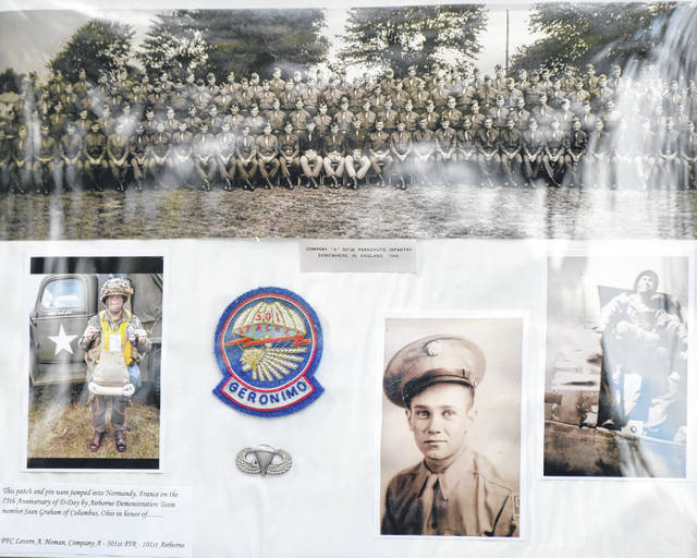 Levern Homan was remembered Saturday with this display of WWII memorabilia. Sean Graham parachuted over Normandy in June and brought with him these jump wings, Homan's picture and a 501st patch.