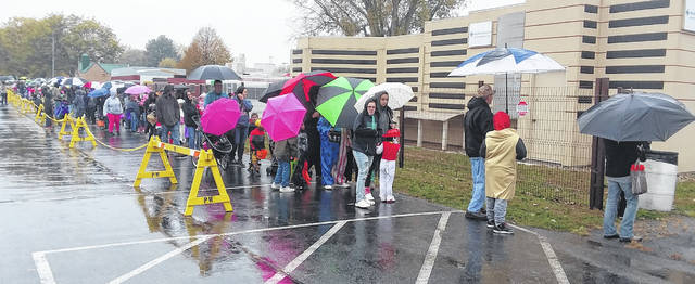 Despite cooler temperatures and steady rain, hundreds of kids and their parents came out to the Safety City Trick or Treat Saturday.