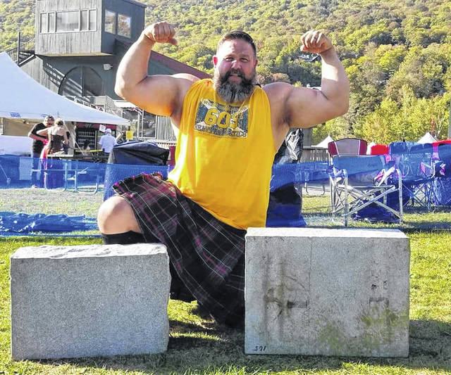 Pictured is Strongman Steve Schmidt with 342-pound and 363-pound stones in New Hampshire on Sept. 21 where he got the world record for stone press.