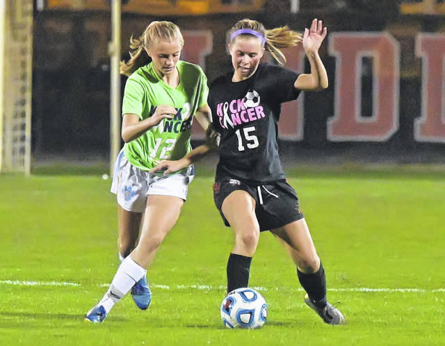 Bath's Lexi Renner, left, and Shawnee's Kennedy Jensen compete for the ball during Tuesday night's match at Shawnee.