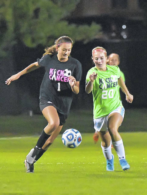 Shawnee's Taylor Morris, left, and Bath's Ainsley Miller compete for the ball during Tuesday night's match at Shawnee.