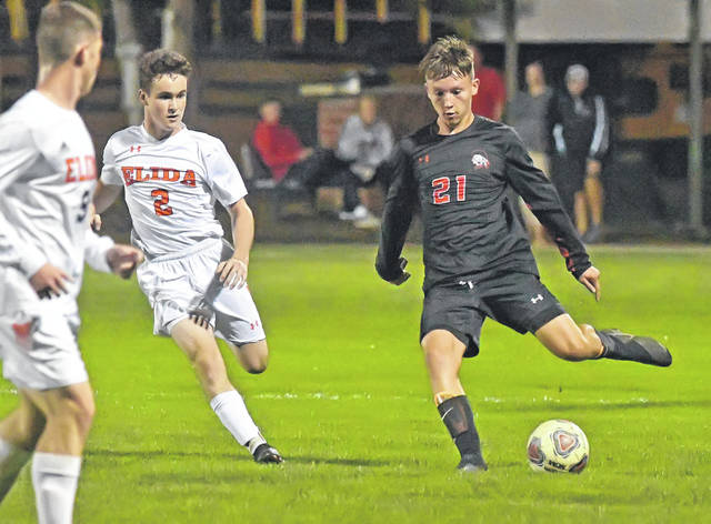 Shawnee's Zach Chambers dribbles against Elida's Ethan Thomas during Thursday night's match at Shawnee High School.