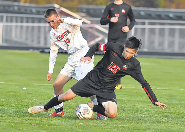Kenton's Trent Yoder, left, and Shawnee's Damien Zeigler compete for the ball during Thursday night's Division II district final at the Elida Sports Complex.