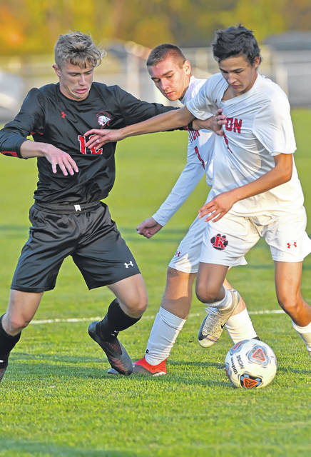 Shawnee's Jacob Miller, left, competes with Kenton's Peyton Roby during Thursday night's Division II district final at the Elida Sports Complex.