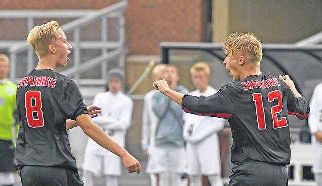 Shawnee's Jacob Miller, right, reacts after scoring a goal with teammate Carter Jensen against Ottawa-Glandorf during Monday's Division II District Semifinal match at the Elida Sports Complex.