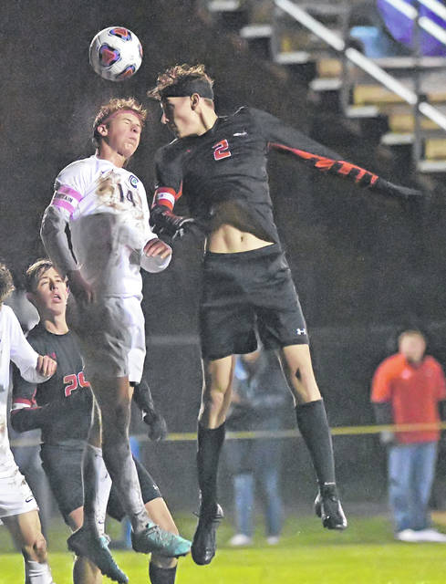 Shawnee's Jack Fraser heads the ball against Toledo Central Catholic's Brett Bishop during Wednesday night's Division II regional semifinal at Graham Memorial Soccer Stadium in Findlay.