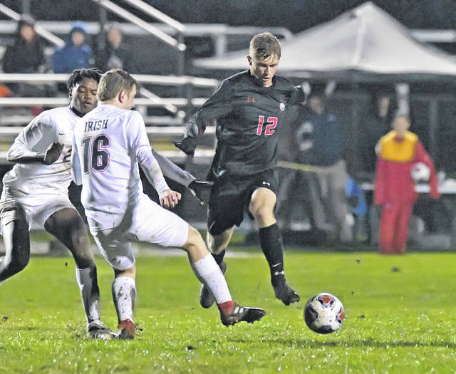 Shawnee's Jacob Miller dribbles against Toledo Central Catholic's Bob Dunning during Wednesday's Division II regional semifinal at Graham Memorial Soccer Stadium in Findlay.