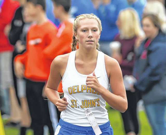 Kambrynn Rohr was the top finisher for Delphos St. John's at the Division III cross country regional Saturday. Richard Parrish | The Lima News