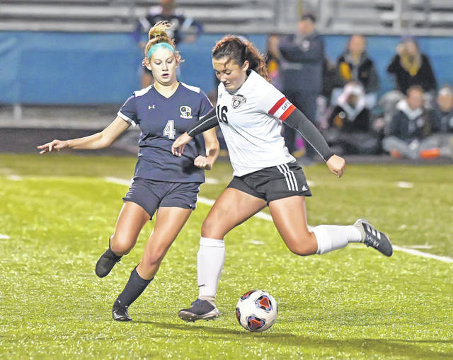 Spencerville's Raygen Martinez dribbles against Archbold's Leah McQuade during Tuesday night's Division III regional semifinal at Fred Brown Stadium in Defiance.