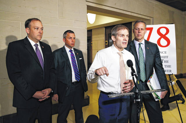 Rep. Jim Jordan, R-Ohio, second from right, speaks to members of the media after National Security Council director for European affairs Alexander Vindman arrived Tuesday for a closed door meeting to testify as part of the House impeachment inquiry into President Donald Trump.