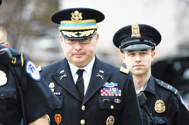 "The arrival of Army Lieutenant Colonel Alexander Vindman (center) in his military blue with medals created a striking image as he entered the Capitol on Tuesday. He told told House investigators that he listened to President Donald Trump's July 25 call with new Ukraine President Volodymyr Zelenskiy and reported his concerns to the NSC's lead counsel. ""I did not think it was proper to demand that a foreign government investigate a U.S. citizen, and I was worried about th implications for the U.S. government's support of Ukraine."""