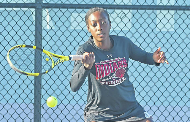 Shawnee's Kunmi Ojo hits a return during singles play at Saturday's Division II sectional at UNOH.