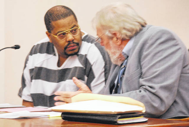 Terry Jackson confers with his court-appointed attorney, Bill Kluge, during a change-of-plea hearing Thursday. Jackson pleaded guilty to two counts of rape and will be sentenced Dec. 2.