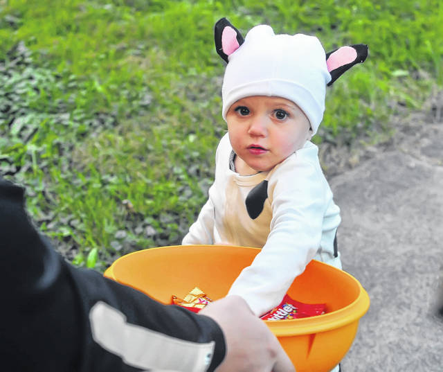 Avery Davis, 1, collects candy dressed as a cow during Cairo's trick or treat.