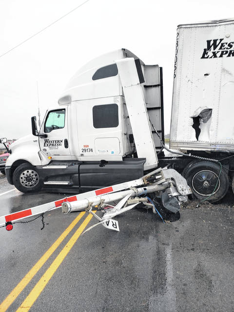 A semi truck failed to negotiate a curve on state Route 65, north of Ottawa near the intersection with Road 7-D, on Thursday morning, damaging the railroad crossing gate.