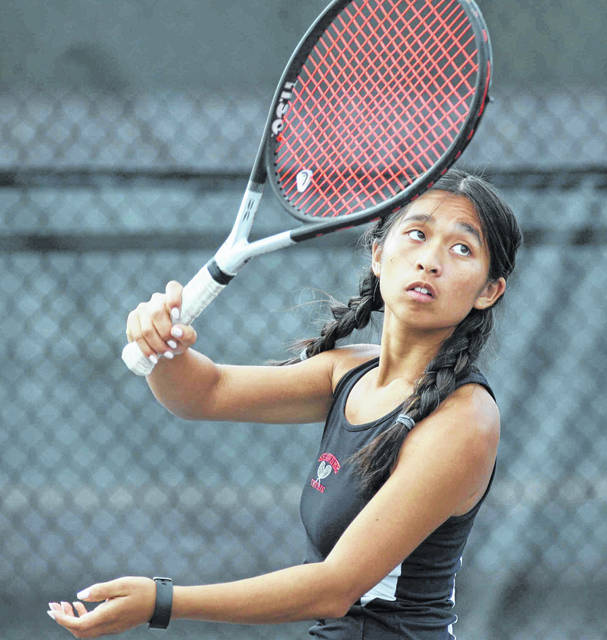 Although she played singles for the majority of her high school career, Alotus Wei transitioned to doubles this year and she partnered with Katie Clark and it resulted in a berth in the state tournament.