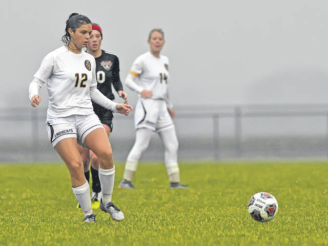 Kalida's McKenna Bockrath dribbles downfield against Spencerville during Saturday's Division III district championship at Ottoville High School.