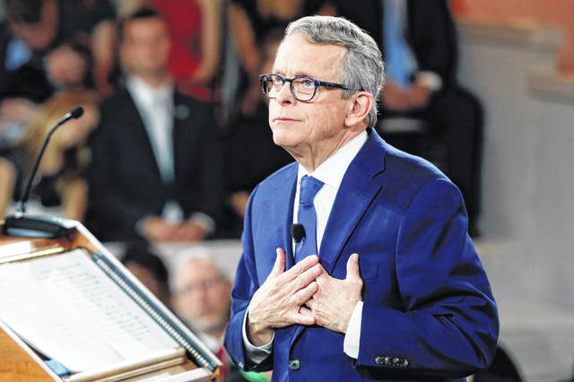 "FILE - In this Jan. 14, 2019, Ohio Gov. Mike DeWine speaks during a public inauguration ceremony at the Ohio Statehouse, in Columbus, Ohio. DeWine says 100 lawyers and government officials from across the state have made a ""positive start"" on deciding how millions of dollars Ohio communities might receive through national opioid litigation settlements should be spent. The Republican governor said a meeting he convened Wednesday, Oct. 23 may serve as a national model. It came after three drug distributors and a major drugmaker agreed to a $260 million settlement over the toll taken by opioids in two Ohio counties."