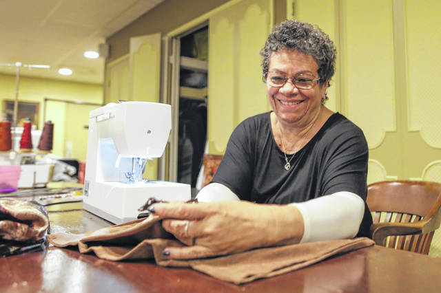 "Vickie Beining sews a costume at dress rehearsal for ""The Jungle Book Kids"" at Encore Theatre on Wednesday. ""It gets the character into the character, if that makes sense,"" Beining said."