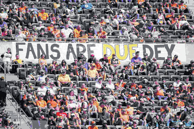 Fans hang a sign from the stands in the first half of an NFL football game between the Cincinnati Bengals and the Jacksonville Jaguars, Sunday, Oct. 20, 2019, in Cincinnati. (AP Photo/Frank Victores)