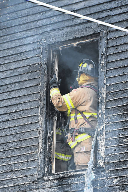 Lima firefighters were on the scene of a house fire at the 300 block of Circular Steet Saturday afternoon.  Richard Parrish | The Lima News