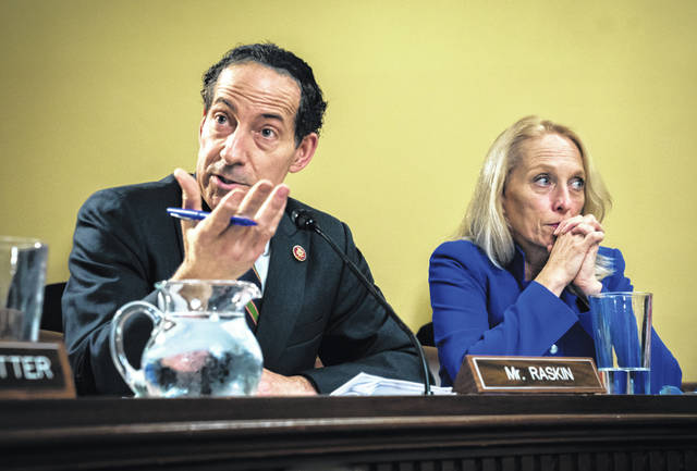 Rep. Jamie Raskin, D-Md., left, and Rep. Mary Gay Scanlon, D-Pa., argue a point as the House Rules Committee holds a markup of the resolution that will formalize the next steps in the impeachment inquiry of President Donald Trump, at the Capitol in Washington, Wednesday, Oct. 30, 2019. Democrats have been investigating Trump's withholding of military aid to Ukraine as he pushed the country's new president to investigate Democrats and the family of rival presidential contender Joe Biden.