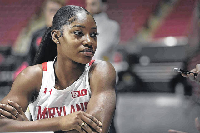 Maryland NCAA college women's basketball player Kaila Charles answers questions during Media Day, Thursday, Oct. 17, 2019, in College Park, Md. (AP Photo/Gail Burton)