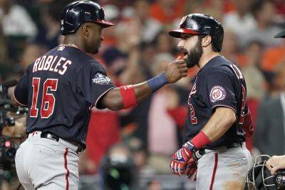 Washington's Adam Eaton is congratulated by Victor Robles after hitting a two-run home run Wednesday night during Game 2 of the World Series in Houston. (AP photo)