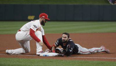 Washington Nationals' Adam Eaton slides safely into third base against the Cardinals' Matt Carpenter during Game 1 of the National League Championship Series on Friday in St. Louis. (AP photo)