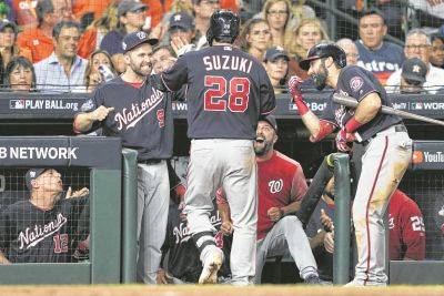 Washington's Kurt Suzuki is congratulated after hitting a home run Wednesday night during Game 2 of the World Series in Houston.