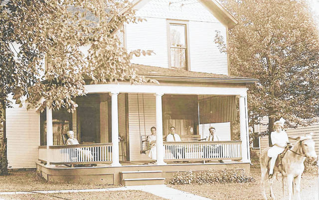 """Judy Overstreet, now of Loveland, recently wrote to explain she and Phyllis Diller shared the same Aunt Hattie and Uncle Allen J. Driver, who lived at 1165 W. High St. (The house still stands.) She notes Diller reminisced about family get-togethers at their house in her autobiography, """"Like a Lampshade in a Whorehouse."""" In the photo that Overstreet shared, Hattie is pictured on the far left. Al is on the far right. Lavon Neely is on the animal. The photo was taken in 1912."""