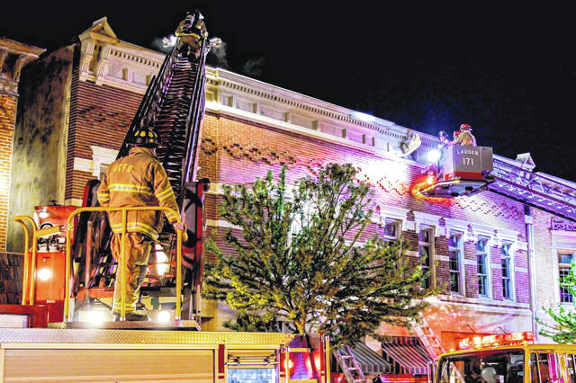 Two ladder trucks were called to the scene to help fight a fire that is believed to have been started in the kitchen of the Inn at Versailles.